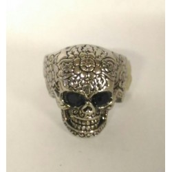 Skull ring with black eyes
